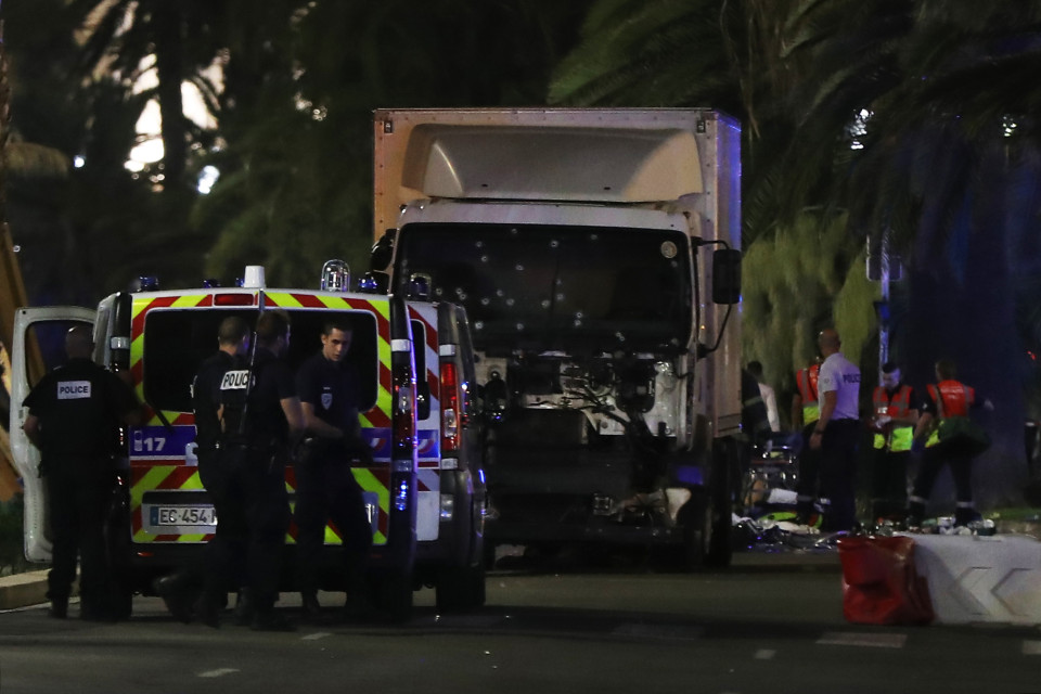 Police officers and rescued workers stand near a van that ploughed into a crowd leaving a fireworks display in the French Riviera town of Nice on July 14, 2016. The mayor of the French city of Nice said dozens of people were likely killed after a van rammed into a crowd marking Bastille Day in the French Riviera resort today and urged residents to stay indoors. / AFP PHOTO / VALERY HACHEVALERY HACHE/AFP/Getty Images