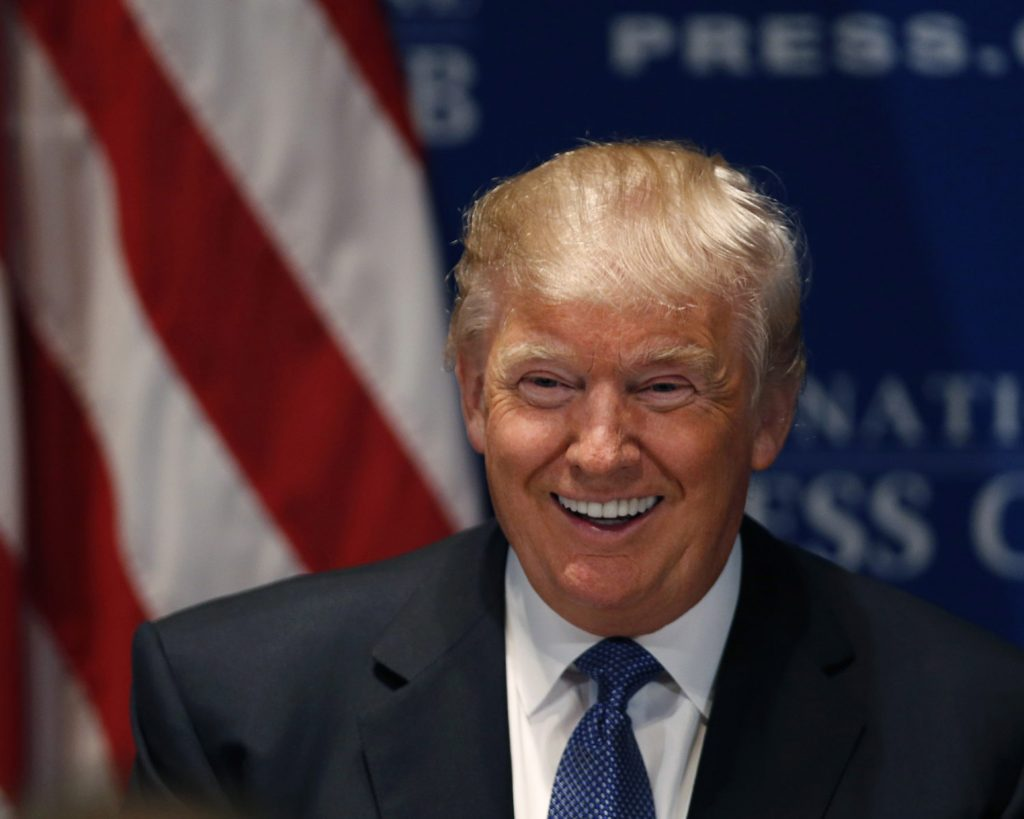 Real estate developer Donald Trump smiles before giving a luncheon speech at the National Press Club in Washington May 27, 2014. REUTERS/Gary Cameron (UNITED STATES - Tags: ENTERTAINMENT BUSINESS REAL ESTATE MEDIA)