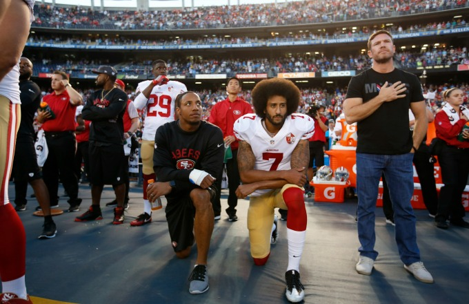SAN DIEGO, CA - SEPTEMBER 1: Eric Reid #35 and Colin Kaepernick #7 of the San Francisco 49ers kneel on the sideline during the anthem, as free agent Nate Boyer stands, prior to the game against the San Diego Chargers at Qualcomm Stadium on September 1, 2016 in San Diego, California. The 49ers defeated the Chargers 31-21. (Photo by Michael Zagaris/San Francisco 49ers/Getty Images)  *** Local Caption *** Eric Reid;Colin Kaepernick;Nate Boyer