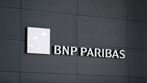 A BNP Paribas logo is pictured on a building of the bank in Geneva July 1, 2014. Switzerland's financial regulator said on Tuesday it was investigating staff at BNP Paribas's Swiss arm after the French bank admitted violating U.S. sanctions against Sudan, Cuba and Iran, in part by using Geneva to conceal wrongdoing.  REUTERS/Pierre Albouy (SWITZERLAND - Tags: BUSINESS LOGO CRIME LAW)