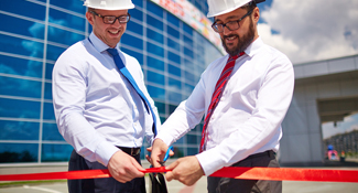 two men at ribbon cutting ceremony