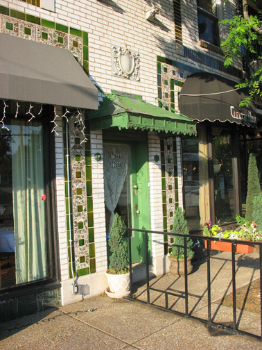 The Stertzing buildings elaborate facade has long been a favorite of Maplewoodians. In this photo from 2006 the metal canopy over the center door and the terra cotta ornament above it can be seen.