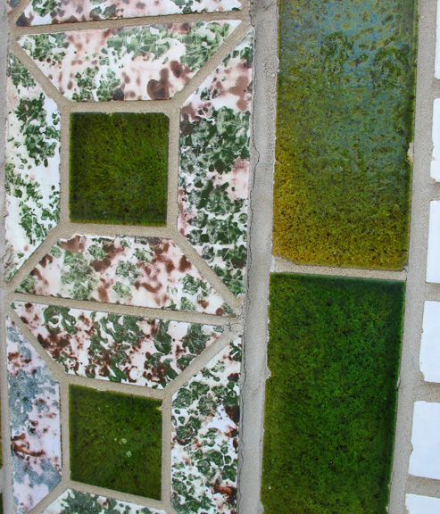 A closeup of the green glazed brick with paired with a glaze that looks to me like mortadella (or am I just hungry?).