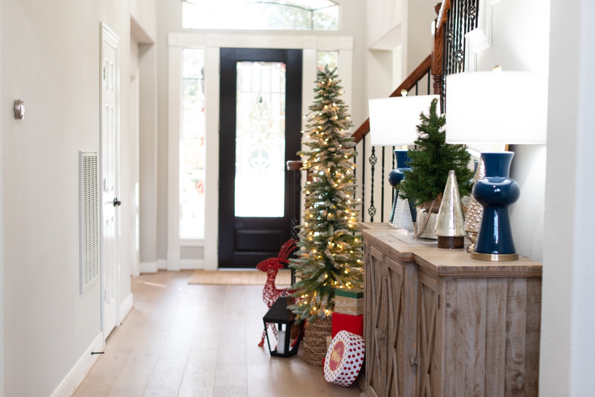christmas entryway | Holiday Home Tour: Festive Christmas Home Decor featured by top Houston life and style blog Haute & Humid