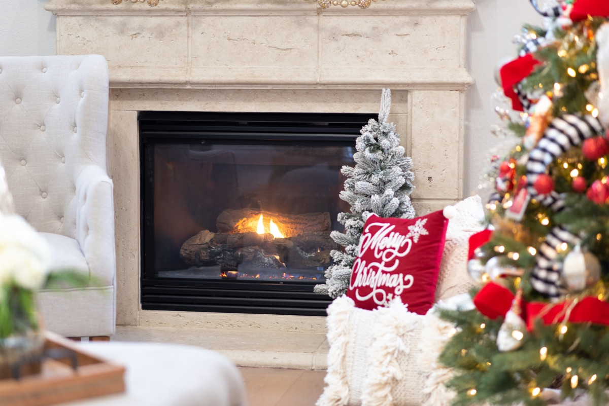 christmas fireplace | Holiday Home Tour: Festive Christmas Home Decor featured by top Houston life and style blog Haute & Humid