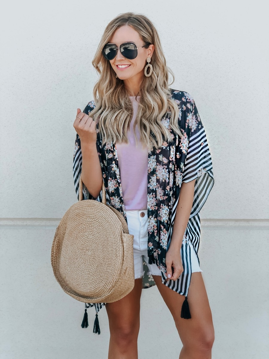 Spring Wardrobe featured by top US fashion blog Haute & Humid; Image of a woman wearing a kimono and white denim shorts from Walmart.