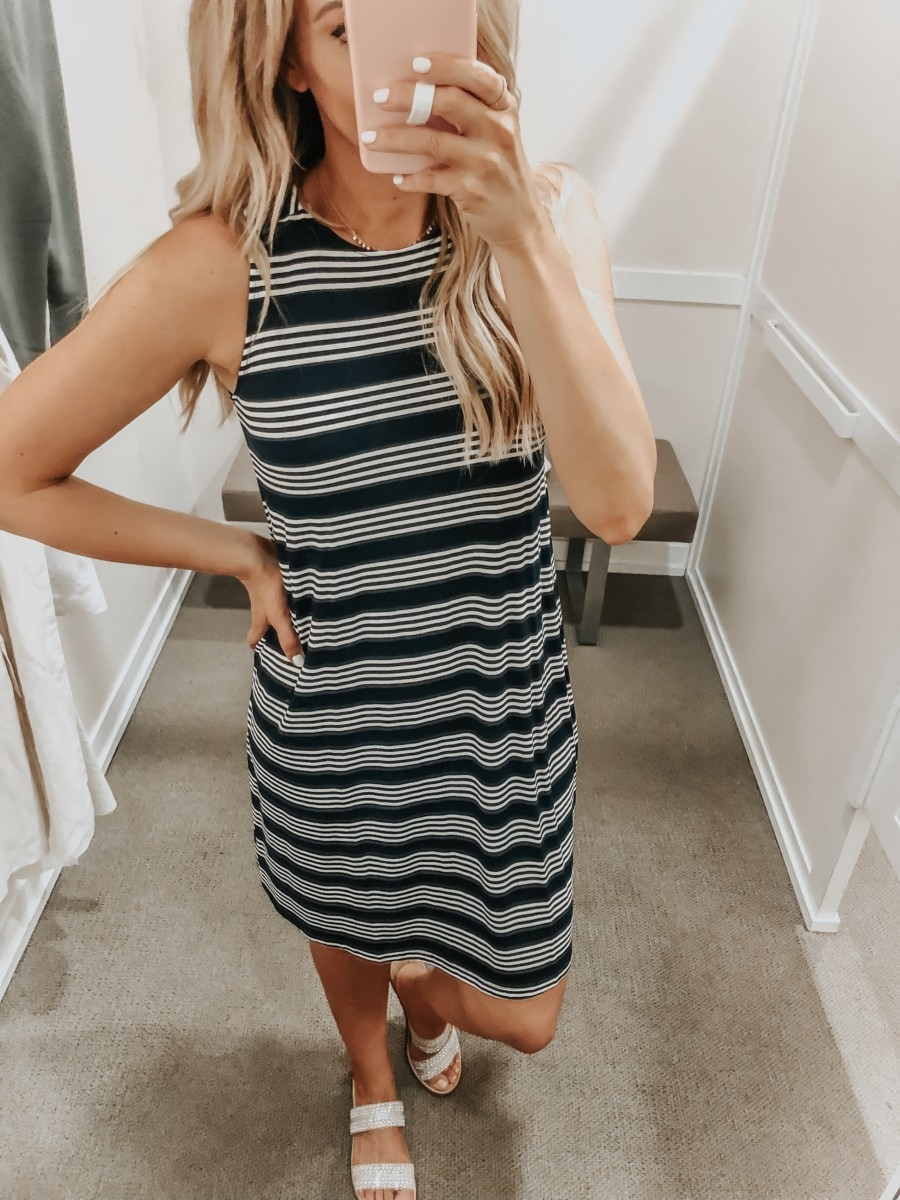 Best Memorial Day Weekend Sales featured by top US fashion blog Haute & Humid; Image of a woman wearing LOFT striped swing dress.