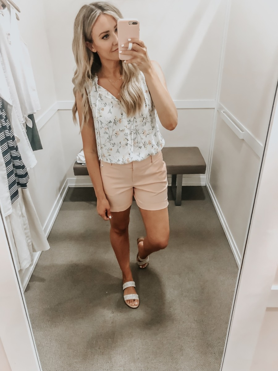 Best Memorial Day Weekend Sales featured by top US fashion blog Haute & Humid; Image of a woman wearing LOFT chino shorts and LOFT blouse.