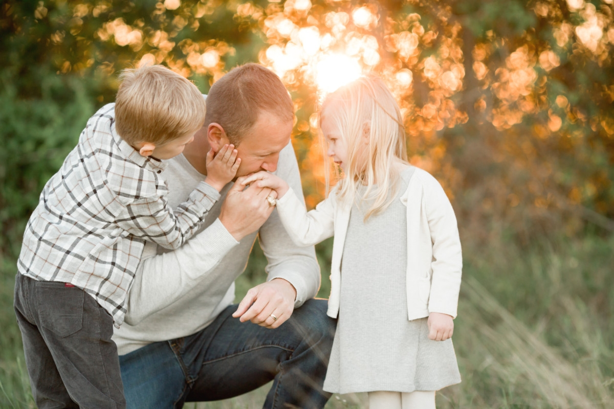 haute and humid blog | popular Houston lifestyle blog | father's day gift guide | Father's Day gift guide featured by top Houston lifestyle blog, haute and humid: image of man with two young kids outside in a field