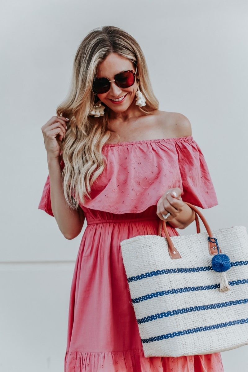 summer dress | 3 Cute Summer dresses by popular Houston fashion blog Haute and Humid: image of woman wearing a pink off shoulder and eyelet Sofia Jeans by Sofia Vergara, brown Circus by Sam Edelman espadrilles, sunglasses, cream hoop tassel earrings, and holding an Eliza May Rose Small Toile Basket Tote from Walmart.