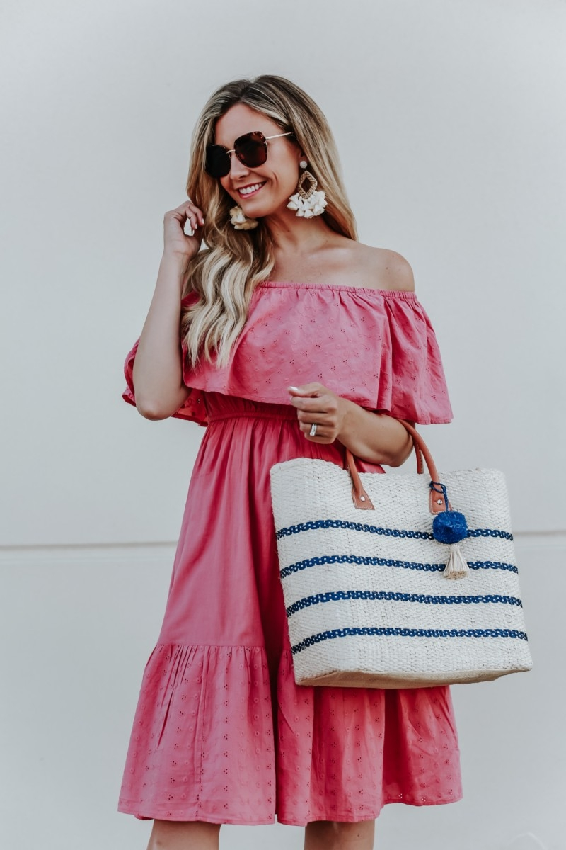walmart dress | 3 Cute Summer dresses by popular Houston fashion blog Haute and Humid: image of woman wearing a pink off shoulder and eyelet Sofia Jeans by Sofia Vergara, brown Circus by Sam Edelman espadrilles, sunglasses, cream hoop tassel earrings, and holding an Eliza May Rose Small Toile Basket Tote from Walmart.