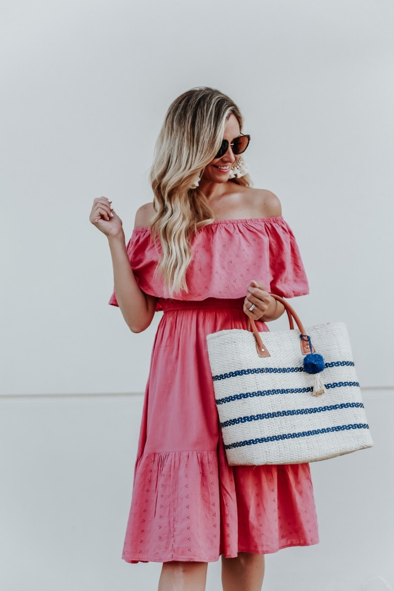 cute summer dress | 3 Cute Summer dresses by popular Houston fashion blog Haute and Humid: image of woman wearing a pink off shoulder and eyelet Sofia Jeans by Sofia Vergara, brown Circus by Sam Edelman espadrilles, sunglasses, cream hoop tassel earrings, and holding an Eliza May Rose Small Toile Basket Tote from Walmart.
