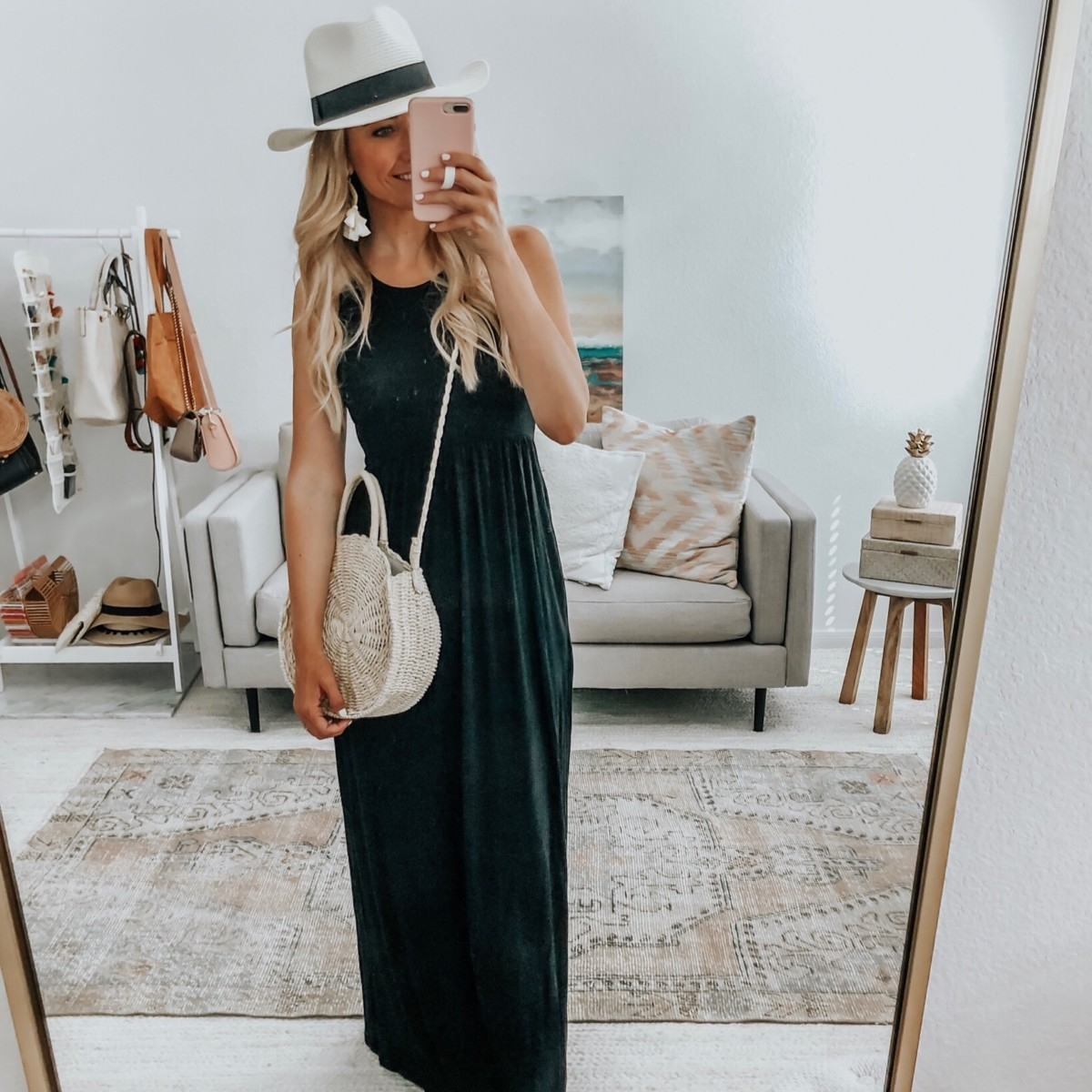 amazon prime day 2019 | Amazon Prime Day 2019 by popular Houston life and style blog, Haute and Humid: image of woman taking a selfie in full body mirror and wearing a black GRECERELLE Women's Sleeveless Racerback Loose Plain Maxi Dresses Casual Long Dresses with Pockets, Airrioal Women Straw Crossbody Bag Summer Beach Weave Shoulder Bag, white Lanzom Women Wide Brim Straw Panama Roll up Hat Fedora Beach Sun Hat UPF50+, and white Meangel Rattan Tassel Earrings for Women Bohemian Statement Handmade Woven Drop Dangle Earrings.