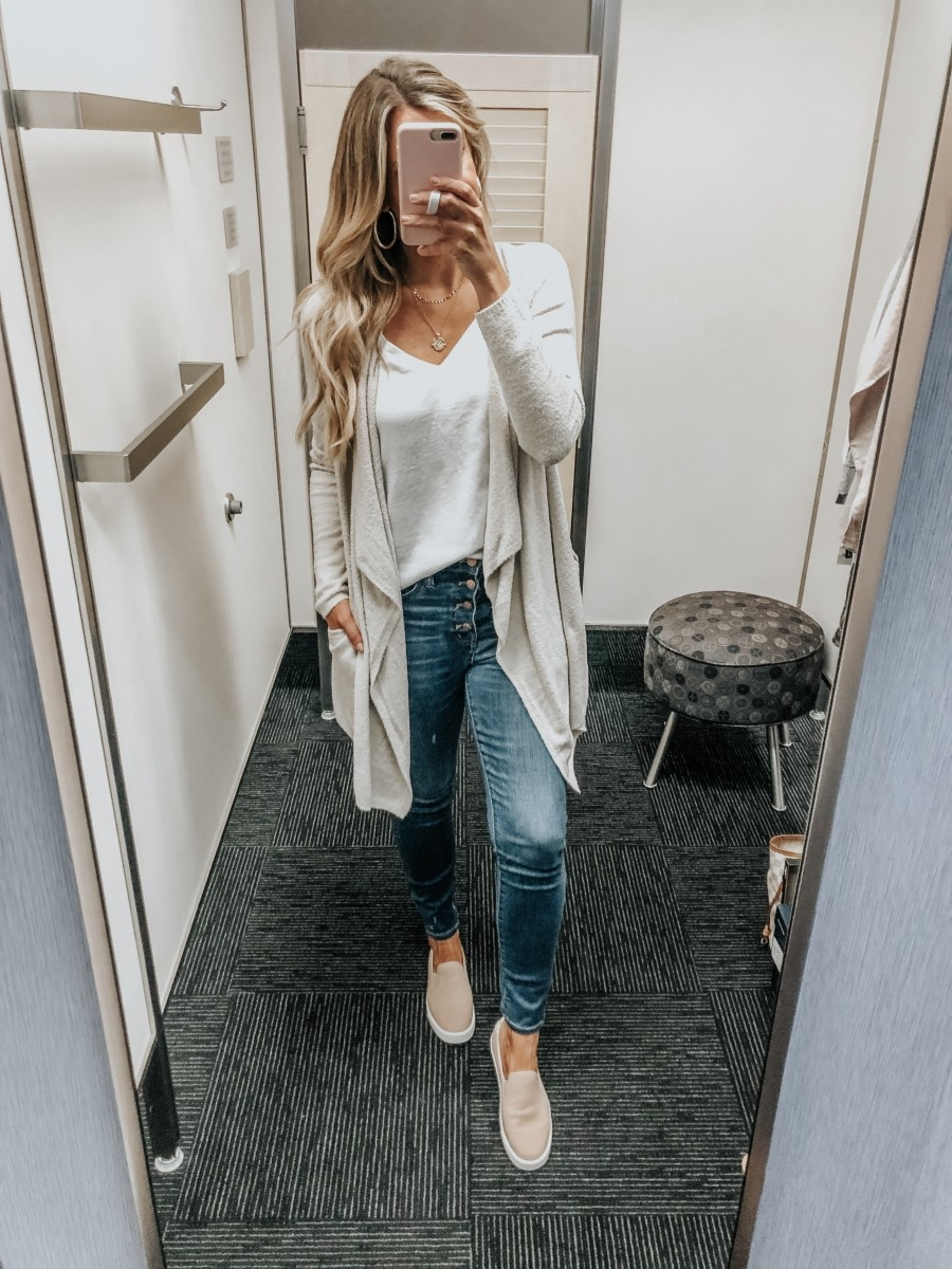 barefoot dreams cardigan | Nordstrom Anniversary Sale Favorites by popular Houston fashion blog, Haute and Humid: image of woman in a dressing room wearing Barefoot Dreams Drape Cardigan, white V-Neck Tee by BP., 10-Inch High Waist Skinny Jeans: Button Front Edition by MADEWELL, and GrandPro Spectator 2.0 Slip-On by COLE HAAN