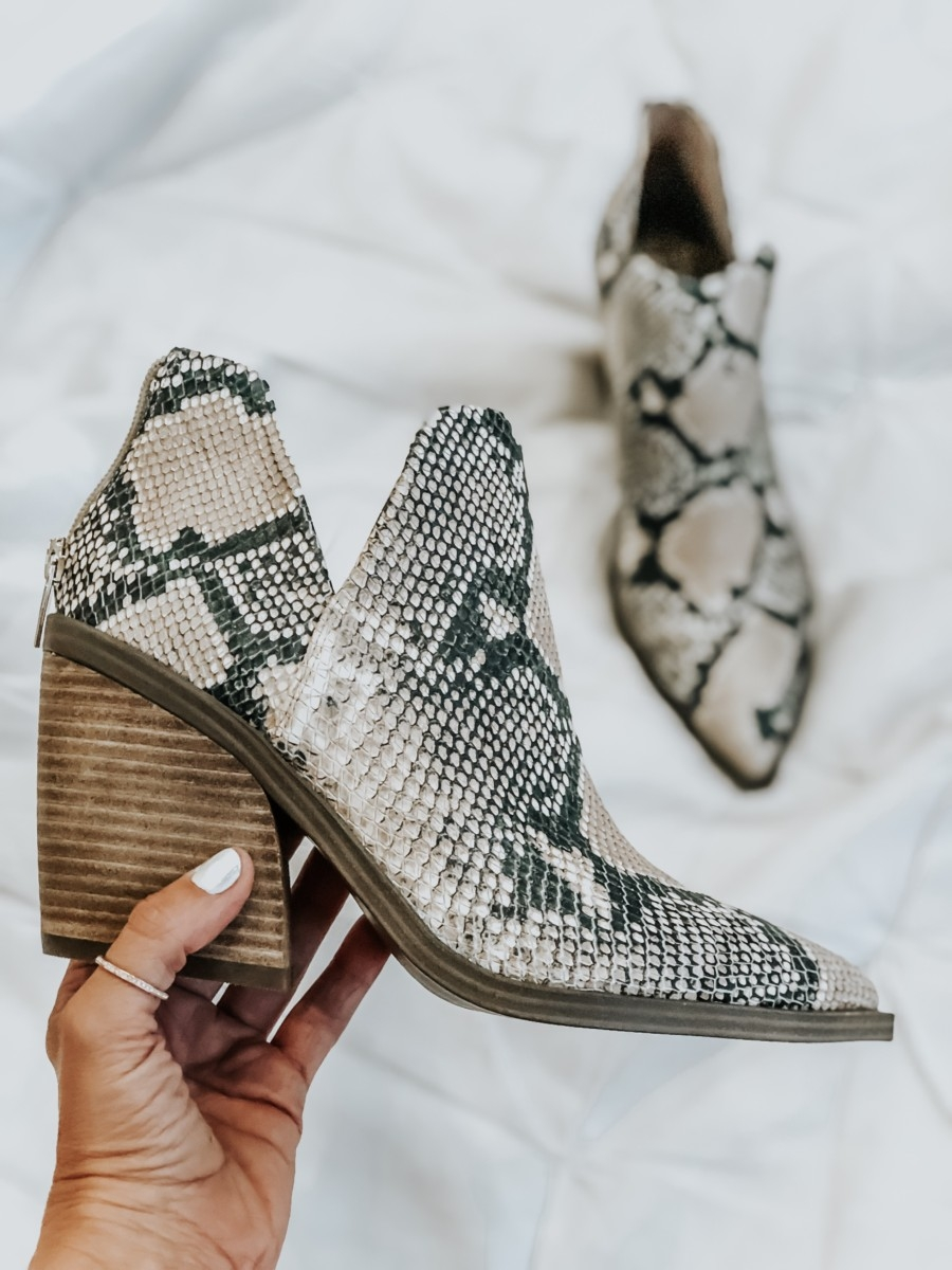snake print bootie | Nordstrom Anniversary Sale Favorites by popular Houston fashion blog, Haute and Humid: image of woman holding a Gigietta Bootie by VINCE CAMUTO