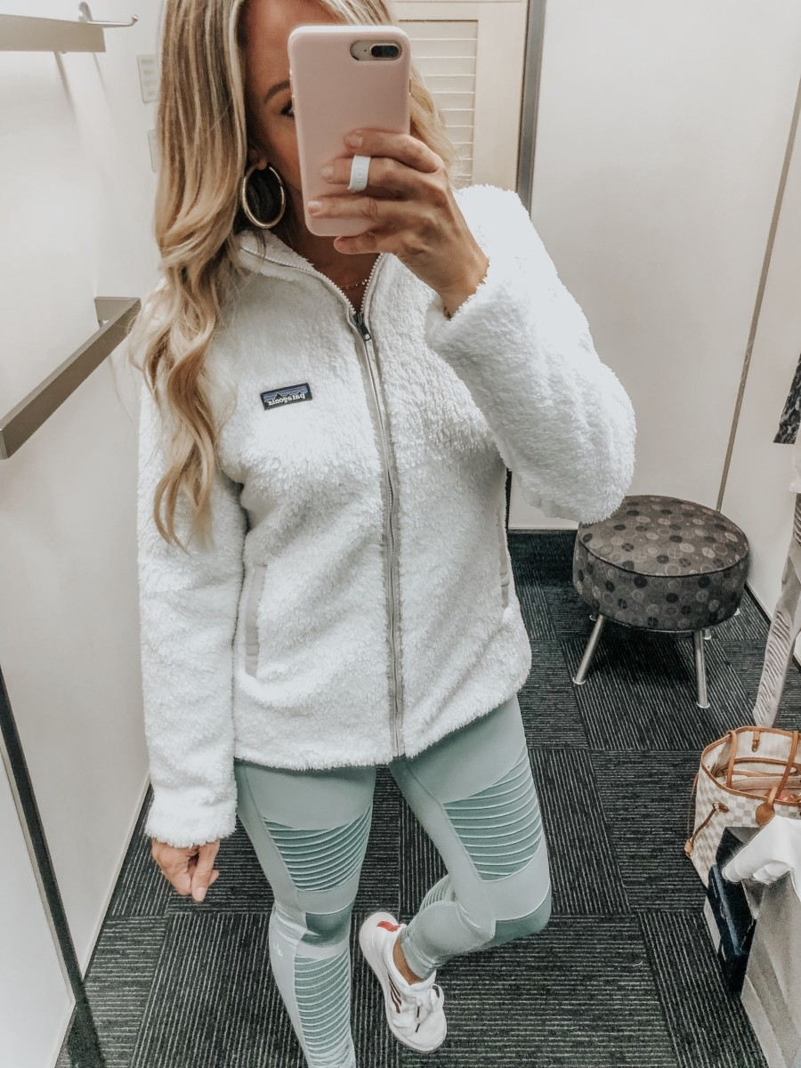 patagonia zip up | Nordstrom Anniversary Sale Favorites by popular Houston fashion blog, Haute and Humid: image of a woman in a dressing room wearing a Los Gatos Fleece Jacket by PATAGONIA, High Waist Moto Leggings by ALO, and white Edge Lux 3 Running Shoe by ADIDAS