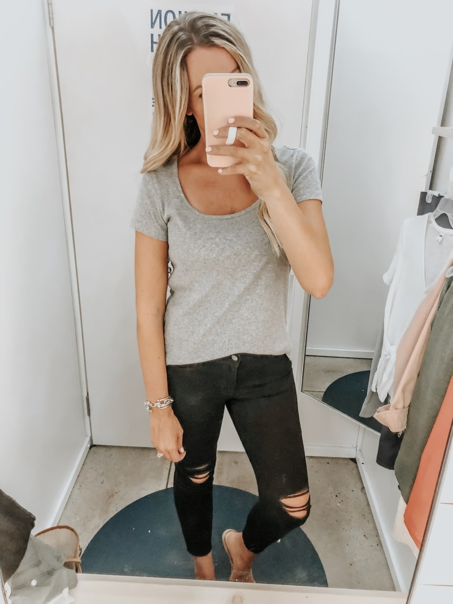 black distressed jeans   Old Navy Try On - August 2019 by popular Florida fashion blog, Haute and Humid: image of a woman standing in a Old Navy dressing room and wearing an Old Navy Slim-Fit Rib-Knit Scoop-Neck Tee and Old Navy High-Waisted Distressed Rockstar Super Skinny Jeans.