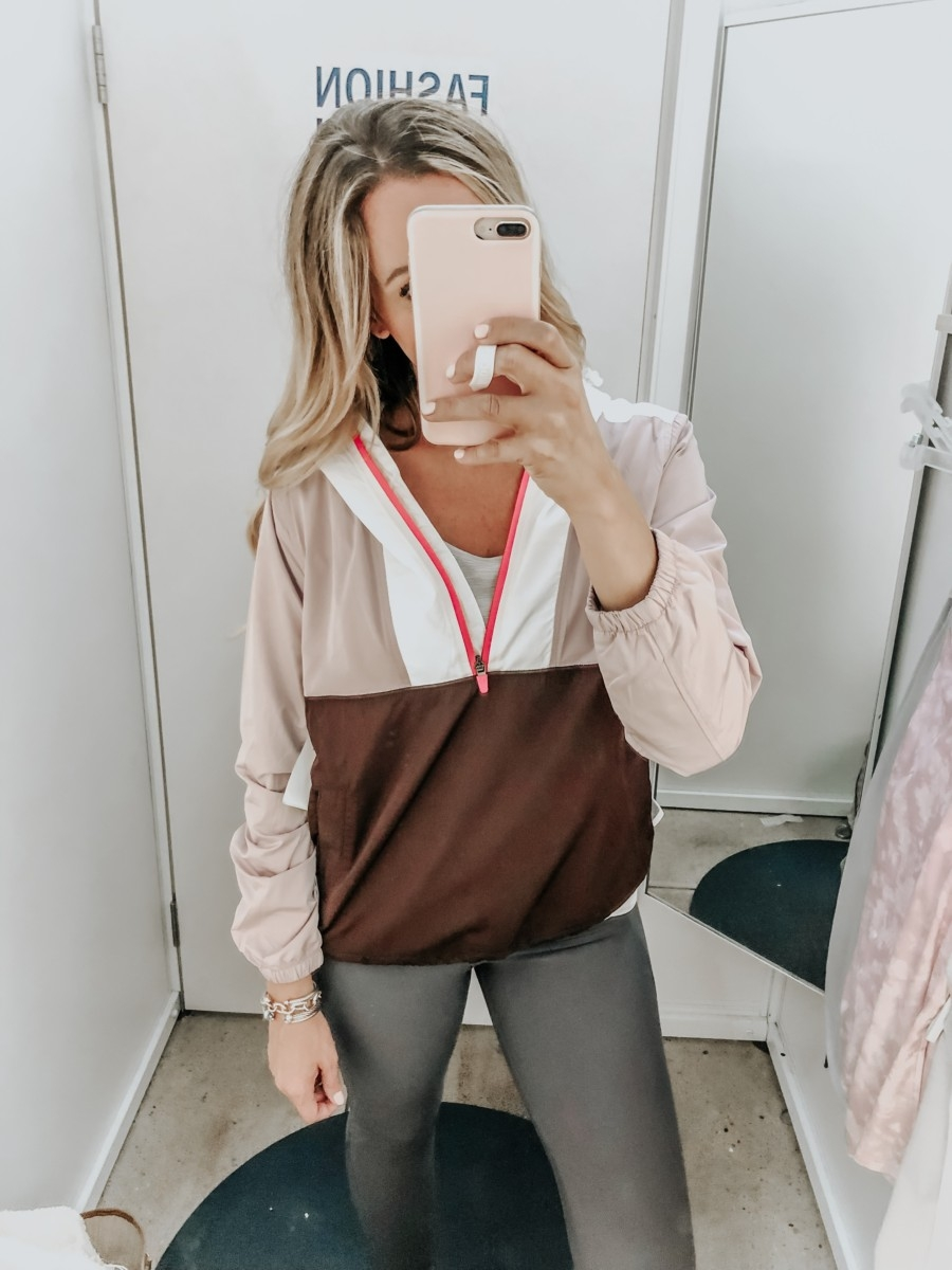 windbreaker   Old Navy Try On - August 2019 by popular Florida fashion blog, Haute and Humid: image of a woman standing in a Old Navy dressing room and wearing an Old Navy Go-H20 Water-Resistant Color-Blocked Anorak and High-Waisted Elevate Built-In Sculpt 7/8-Length Compression Leggings.