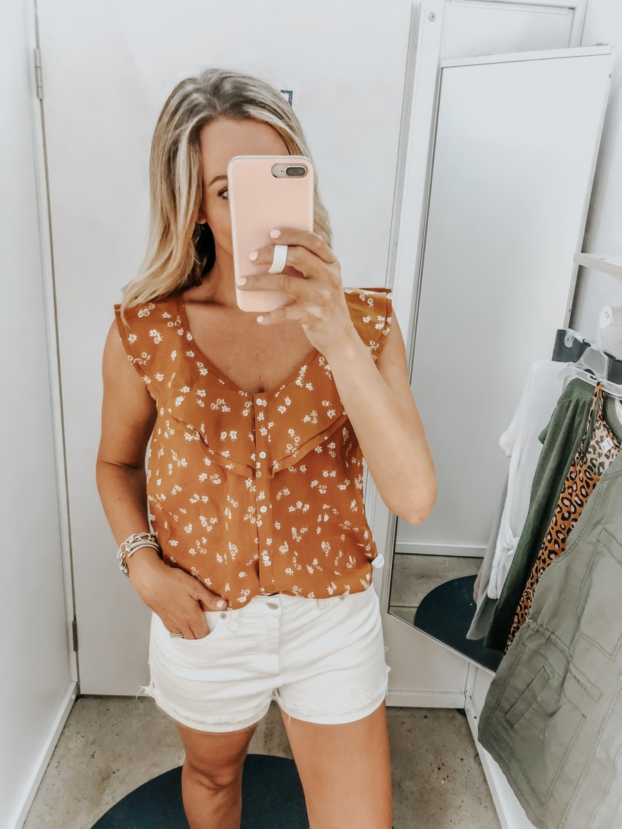 old navy try on   Old Navy Try On - August 2019 by popular Florida fashion blog, Haute and Humid: image of a woman standing in a Old Navy dressing room and wearing an Old Navy Ruffle-Tiered Linen-Blend Button-Front Blouse and Madewell High Waist Denim Shorts.
