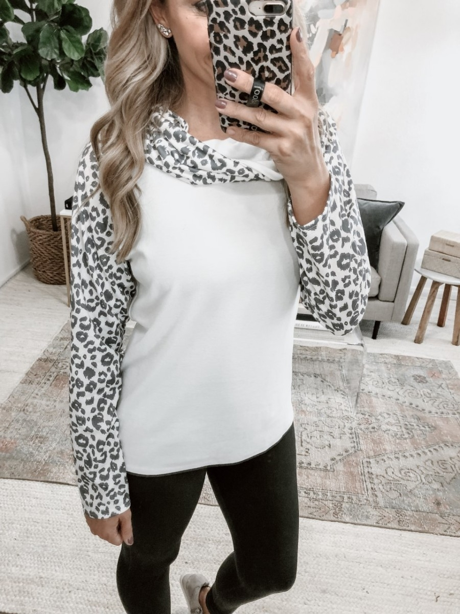 leopard sweatshirt | 5 Best Amazon Leggings Reviewed And Rated by popular Houston fashion blog, Haute and Humid: image of a woman wearing Amazon Amazon Essentials Women's Performance High-Rise Full Length Active Legging and Amazon LAMISSCHE Womens Casual Sweatshirts Long Sleeve Leopard Print Tops Cowl Neck Raglan Shirts.