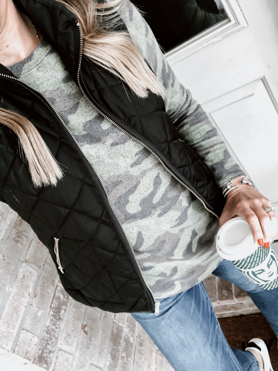 black friday sales | The Best Black Friday Shopping Guide by popular Houston life and style blog, Haute and Humid: image of a woman wearing a J. Crew Puffer vest, American Eagle AE NE(X)T LEVEL JEGGING, and Walmart Time and Tru Time and Tru Women's Time and Tru Fashion Sneaker.