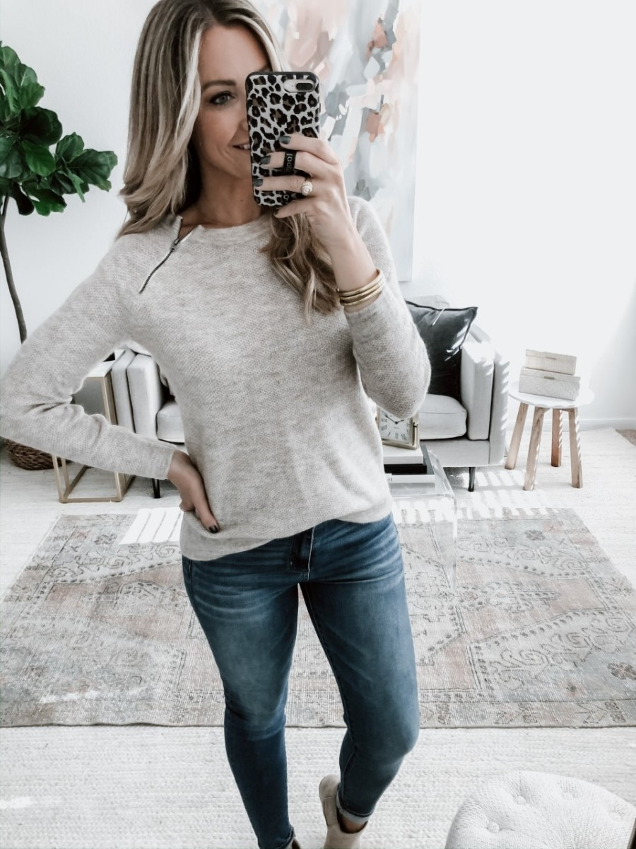 abercrombie black friday | The Best Black Friday Shopping Guide by popular Houston life and style blog, Haute and Humid: image of a woman wearing a Abercrombie and Fitch Pullover Zipper Crew Sweater.