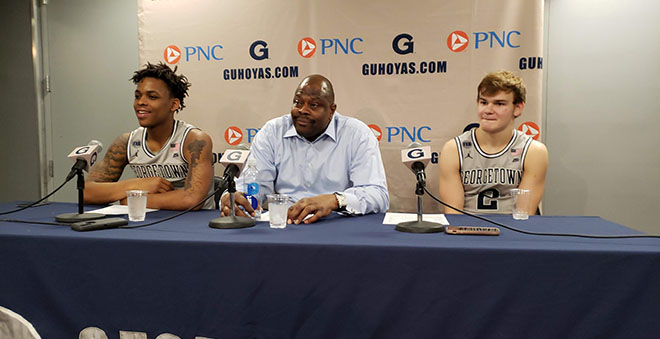 Patrick Ewing sits with Mac McClung and James Akinjo after win over UALR. Photo Credit: Marcus Washington/Making the Cut