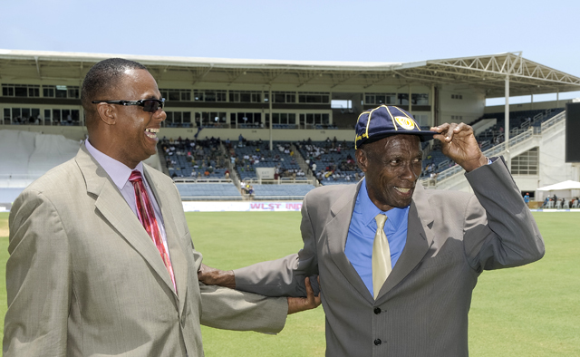 Sir Wes Hall (right) receiving his cap from Courtney Walsh at Sabina Park, Jamaica. Photo by WICB Media/Randy Brooks of Brooks Latouche Photography