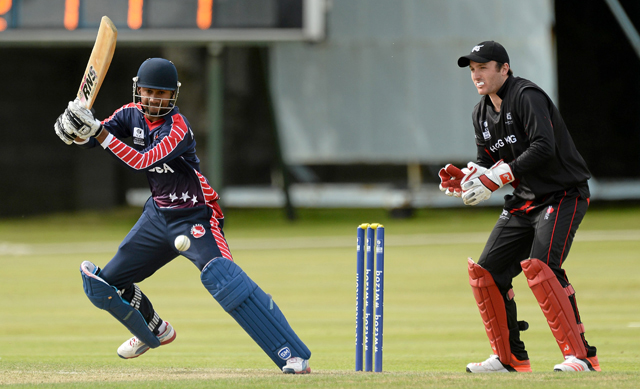 Alex Amsterdam bats during this unbeaten 43. Top, Nicholas Standford poses with the man-of-the-match award for knock of 40 not out, both batsmen ensure the win for USA. Picture credit: Oliver McVeigh / ICC / SPORTSFILE