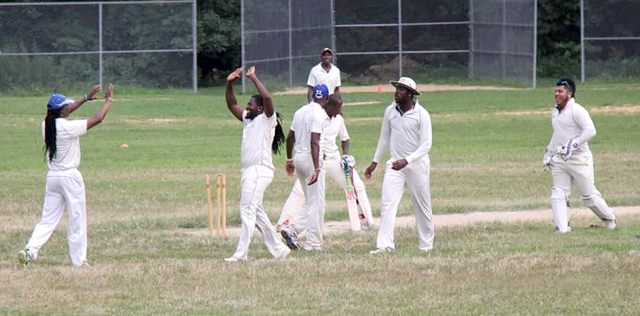 Gayle congratulated by teammates after claiming the wicket of Durrel Forrest.