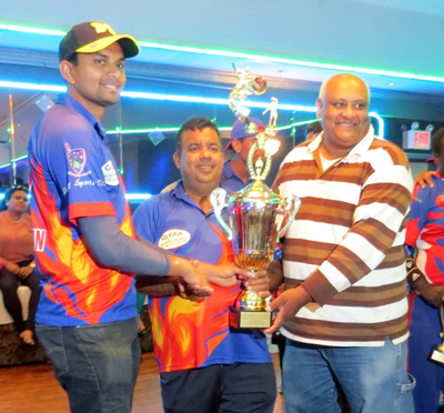 Captain Danesh Deonarain and manager Tooneshwar Kristona, being presented with a trophy for winning the 2015 EACA Championship.
