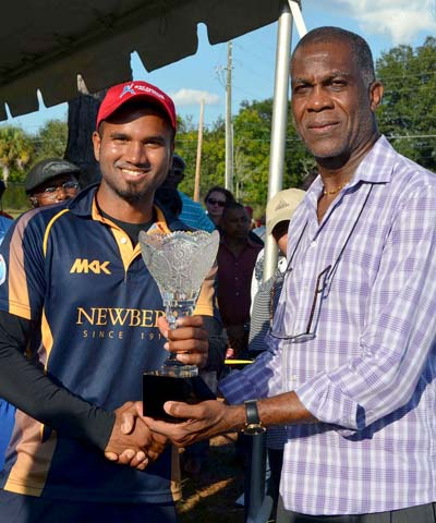 Former Windies Test fast bowler Michael Holding presents championship trophy to Patriots skipper Jaideep Reddy.