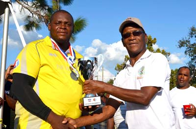 Oneil Hylton All Stars skipper receives runner-up trophy from Windies Test legend Lawrence Rowe.