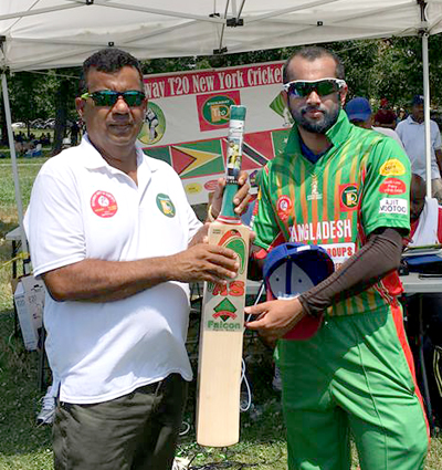 Arif Islam, right, collects his man-of-the-match award from tournament sponsor Hafeez Ali. Photo by Javed Ali.