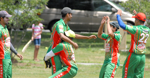 Bangladesh celebrate the fall of a wicket.