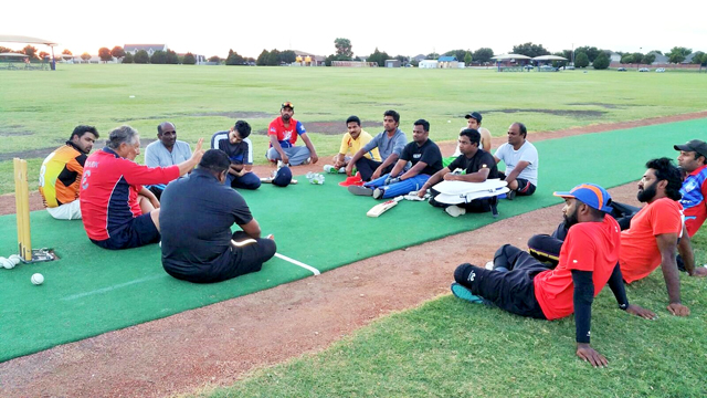 Fahad Shahnawaz (extreme left) listens to coach Mark Demos from Zimbabwe address Dallas Cricket League players set to participate in an inter-city tournament in Houston, TX.