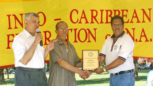 Former British Guiana Player Sunny Basdeo receiving his award from ICF President Ralph Tamesh also in picture is Dr Dhanpaul Narine.