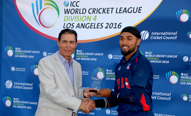 Jasdeep Singh (right) receives the man of the match award after picking up 3 for 29 and contributing a vital 37 not out to help USA win the final.