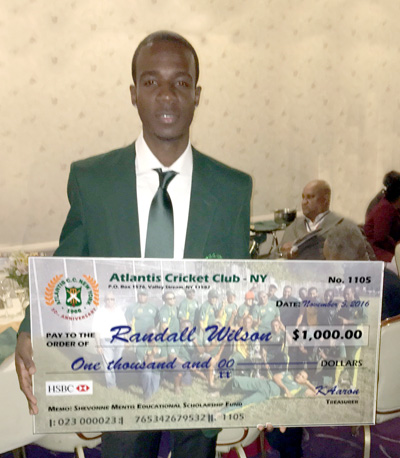 2016 Most Promising Player and Shevonne Mentis Educational Scholarship Fund recipient Randall Wilson cradles his $1,000.00 check.