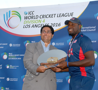 USA skipper Steven Taylor (right) collects the winning ICC World Cricket League Division 4 championship plate after USA defeated Oman. Photos by Shiek Mohamed