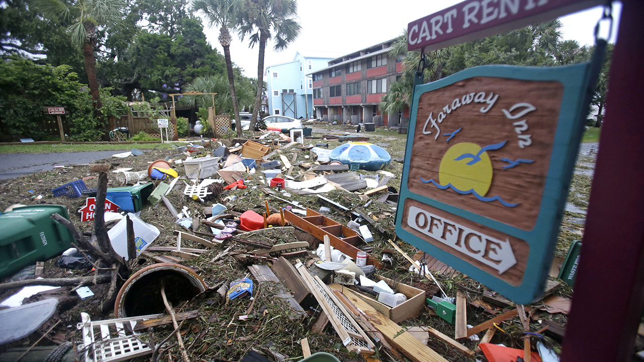 A street is blocked from debris washed up from the tidal surge of Hurricane Hermine Friday, Sept. 2, 2016, in Cedar Key, Fla. Hermine was downgraded to a tropical storm after it made landfall. (AP Photo/John Raoux)