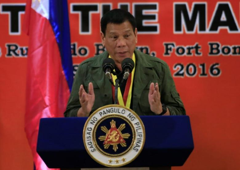 Philippines President Rodrigo Duterte delivers a speech to members of the Philippine Marines during a visit at the marines headquarters in Taguig city, metro Manila, Philippines September 27, 2016.  REUTERS/Romeo Ranoco