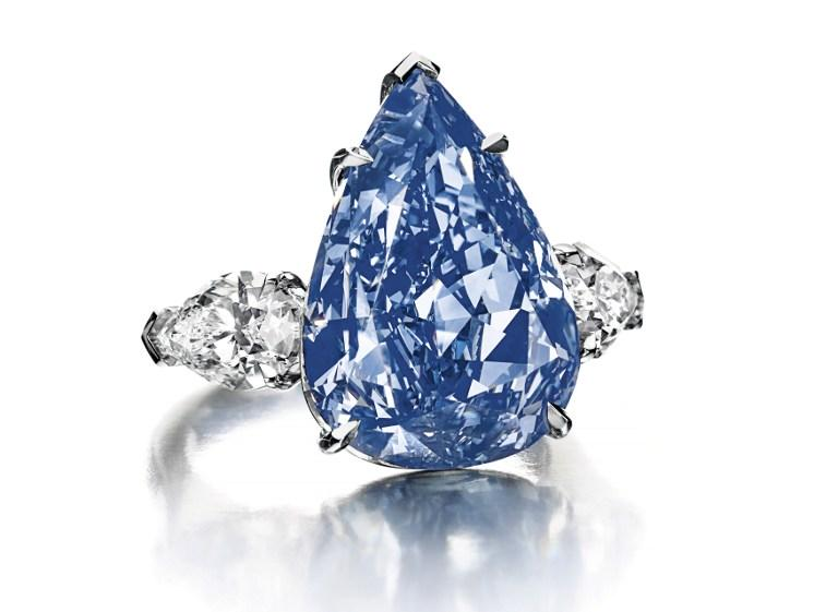 At a Christie's auction, a 13.22-carat pear-shaped blue diamond sold for $23.8 million