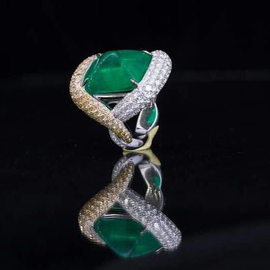 A 16.95 carat Colombian Emerald sugar loaf ring by Smart Arts.