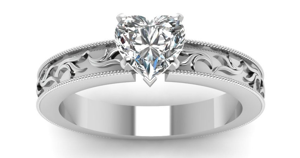 This heart shaped diamond solitaire twig design engagement ring has a GIA Certified 0.80 Ct Diamond Cut:Very Good SI1-H Color. This engagement ring is enhanced by an intricate leaf pattern in a sequence and a milgrain outline all around the ring.