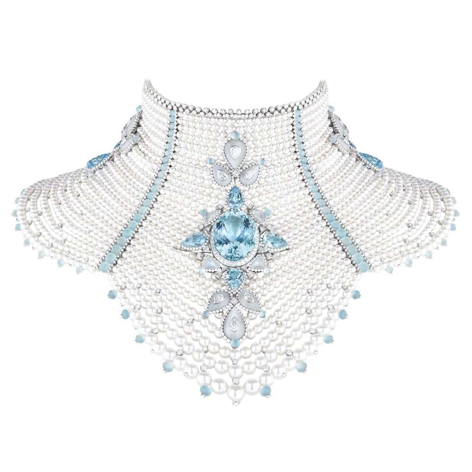 BAÏKAL Necklace set with a 78,33 ct Santa Maria oval aquamarine, moonstones and cultured pearls, paved with diamonds and aquamarines, on white gold.