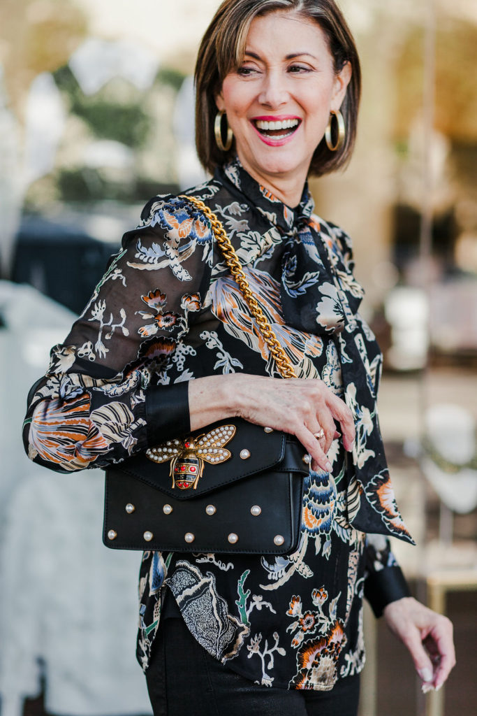 Over 50 Dallas blogger in print bow blouse