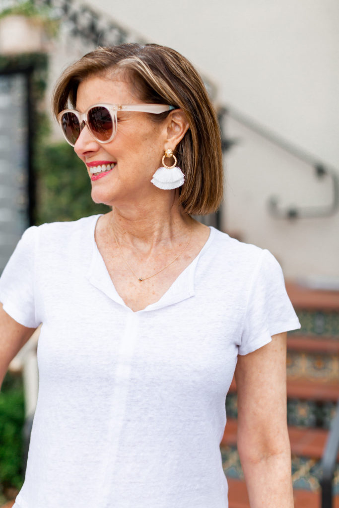 feather earrings on trend