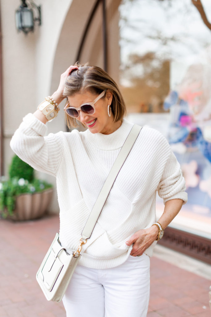 horn cuffs and beaded bracelets on over 50 dallas blogger