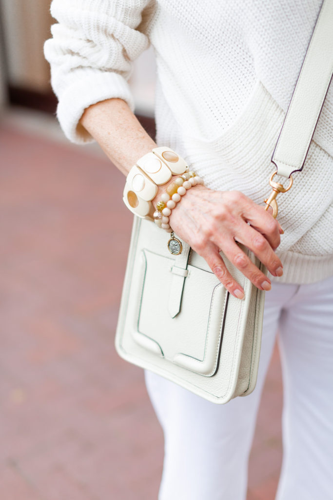 stack up the bracelets with cross body Rebecca Minkoff bag